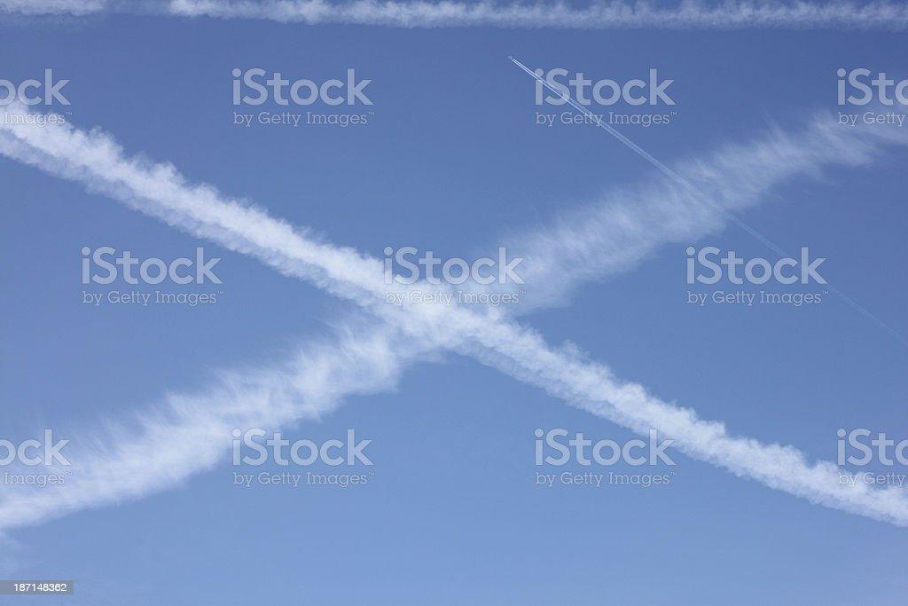 Cross in the blue sky stock photo