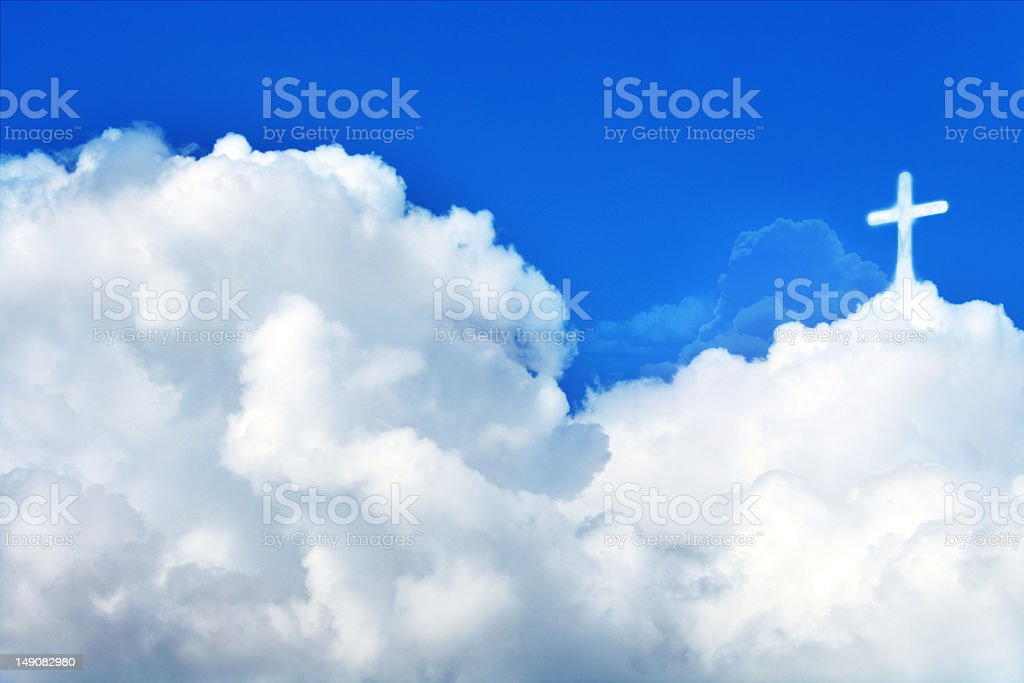 Cross in the clouds royalty-free stock photo