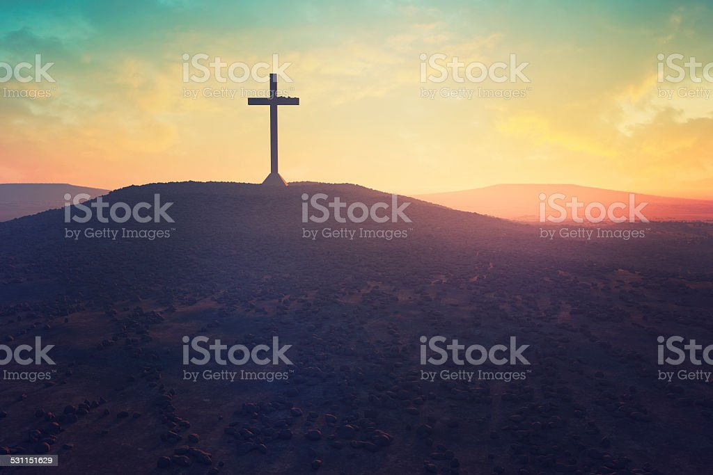 Cross in the middle of a desert stock photo