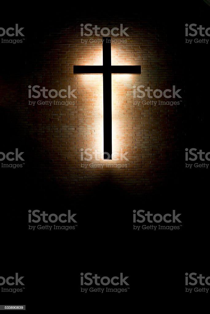 Cross lighting on wall stock photo