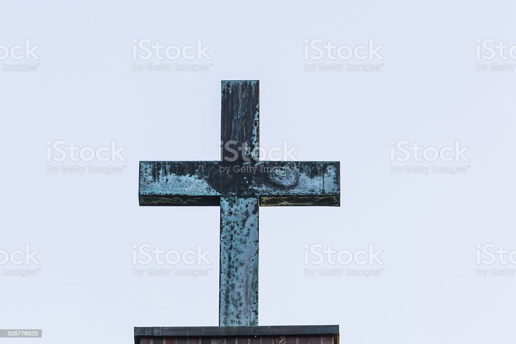 Cross made of metal stock photo