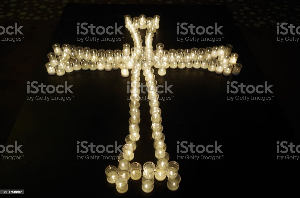 Cross made with candles stock photo