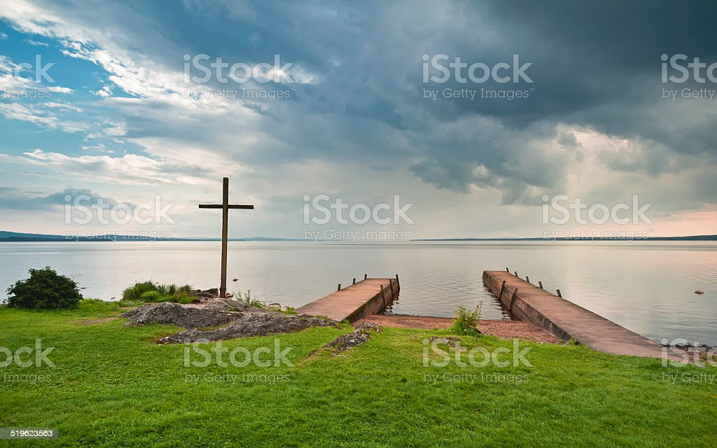 Cross near a jetty in Norway stock photo