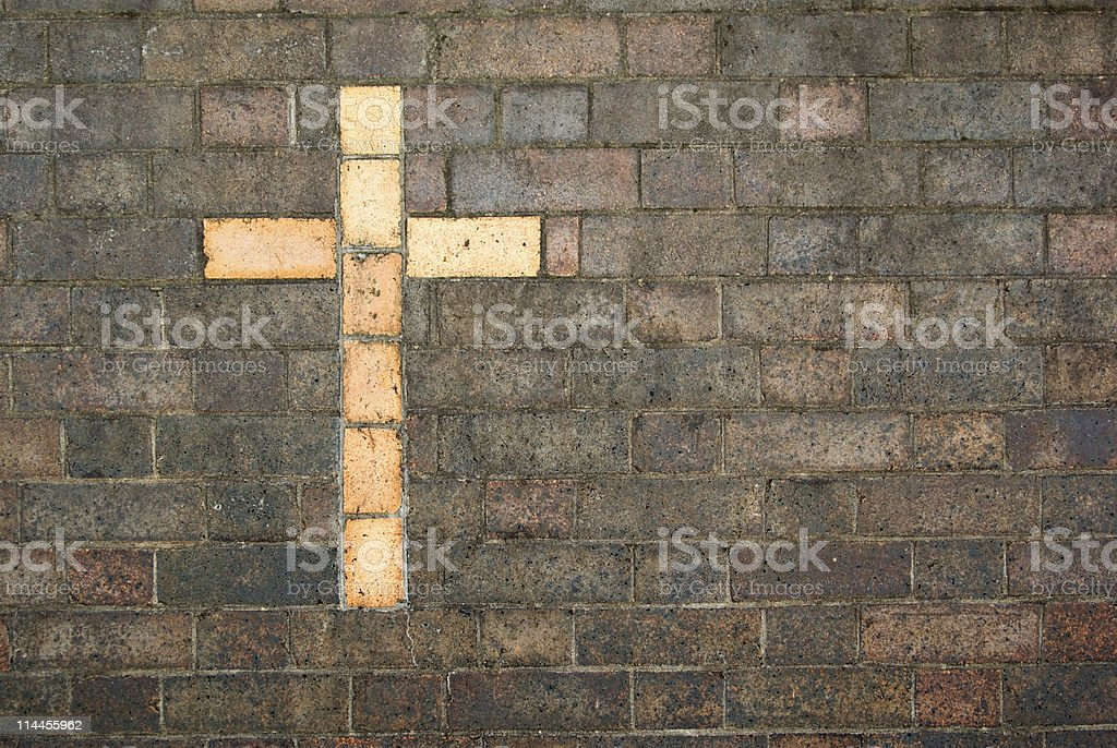 cross of christ built into a brick wall royalty-free stock photo