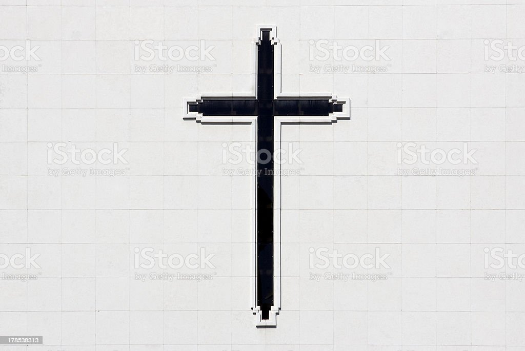 Cross of Christ on white wall royalty-free stock photo