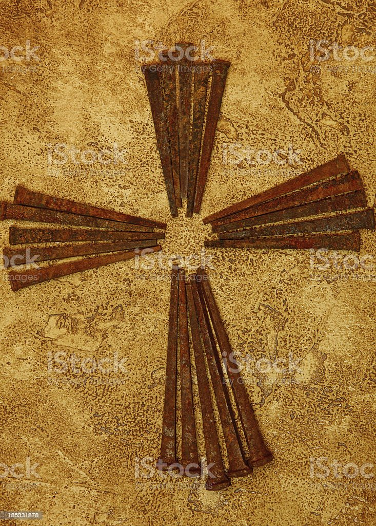Cross of Old Square Rusty Nails stock photo
