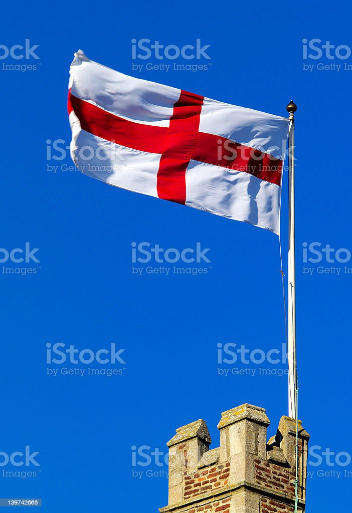 Cross of St George flying from castle ramparts stock photo