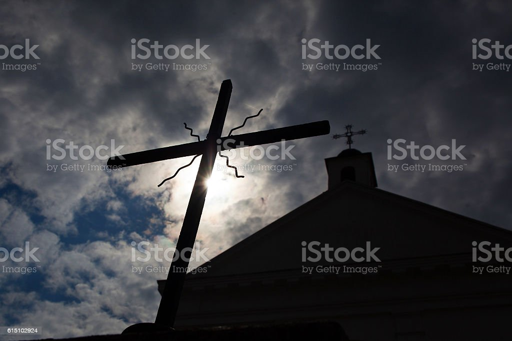 cross on a background of the sun and the church royalty-free stock photo