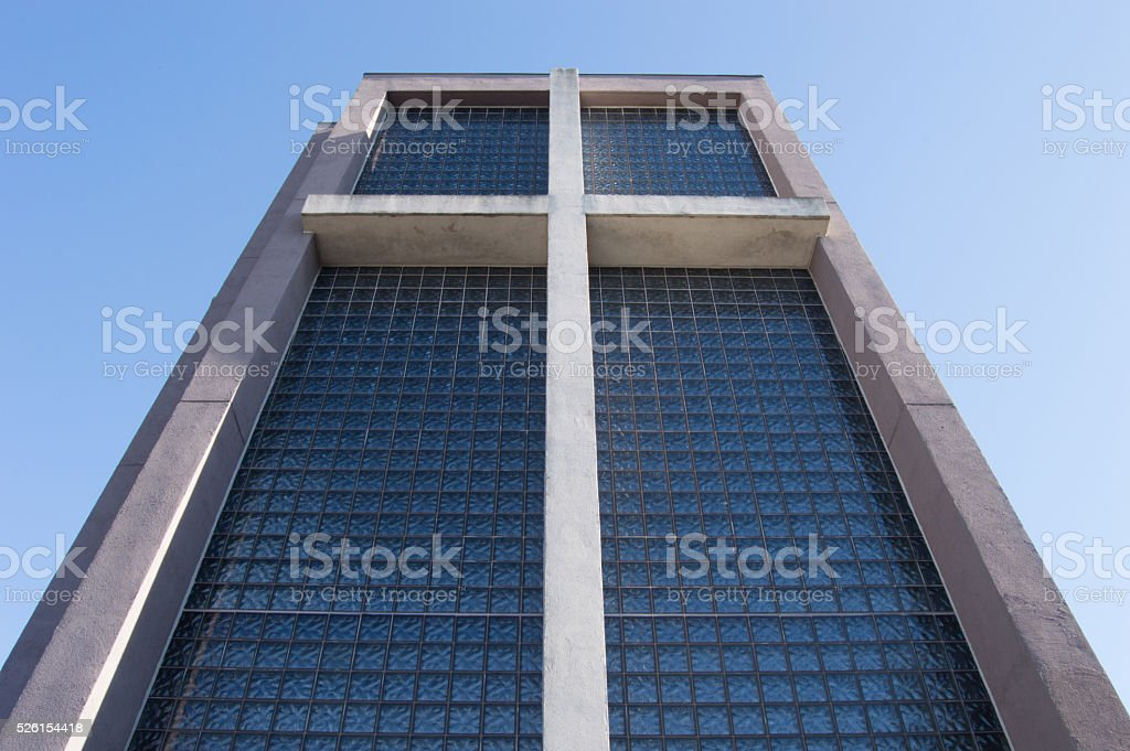cross on a glass wall stock photo
