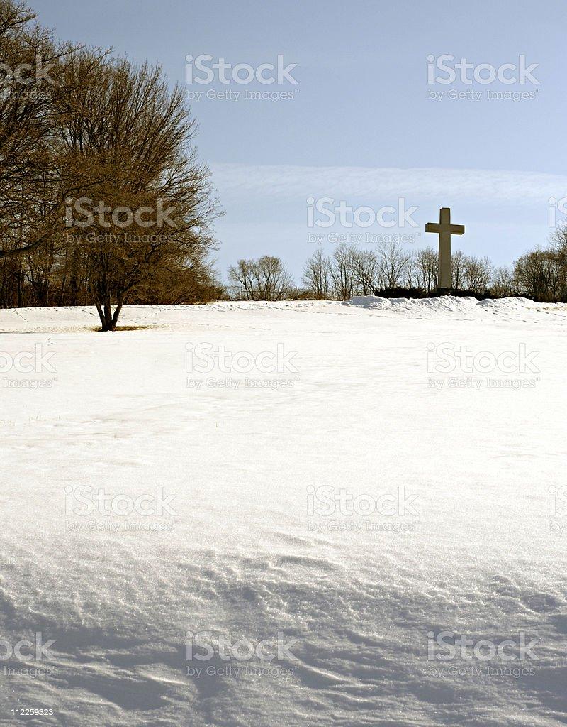 cross on a snow bank stock photo