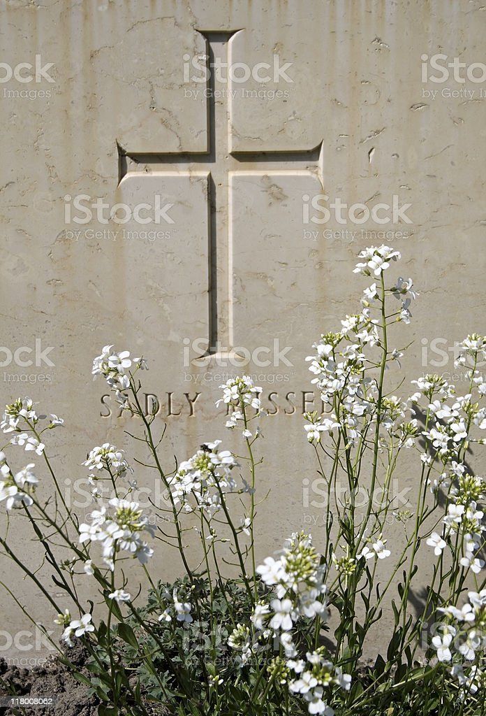 Cross on a tombstone with inscription royalty-free stock photo