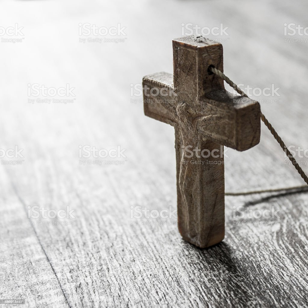 cross on a wooden surface stock photo