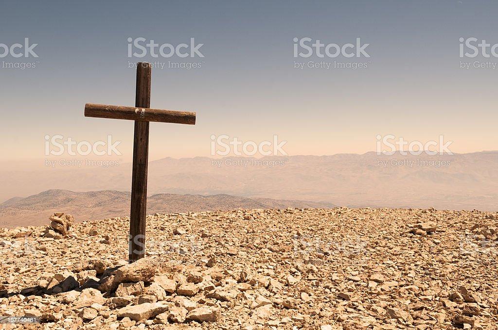 Cross on barren mountaintop in Lebanon stock photo