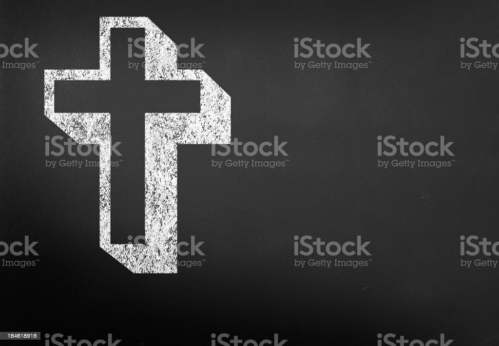 Cross on blackboard stock photo