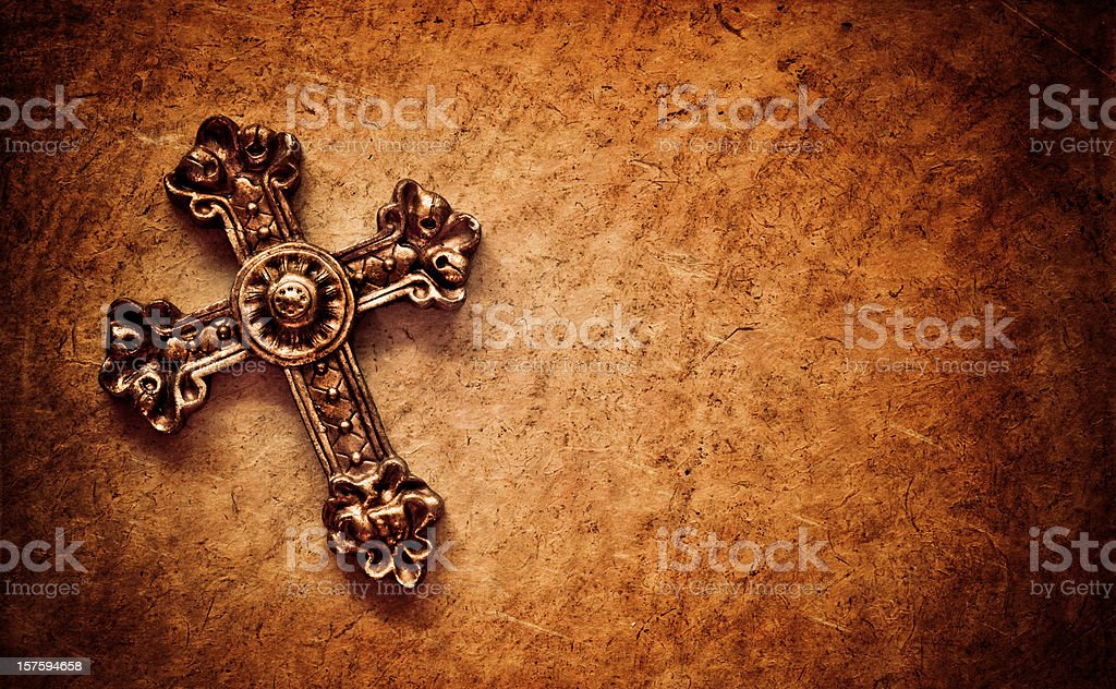 cross on brown paper background stock photo