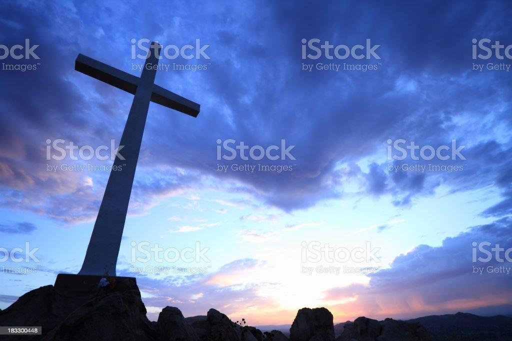 Cross on Hill at Sunrise stock photo