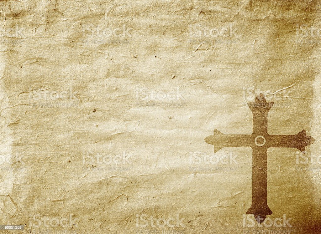 Cross on parchment paper royalty-free stock photo