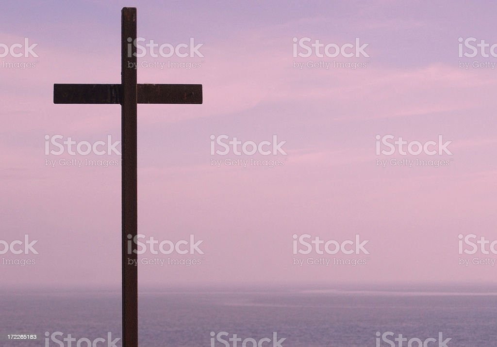 Cross on purply sky royalty-free stock photo