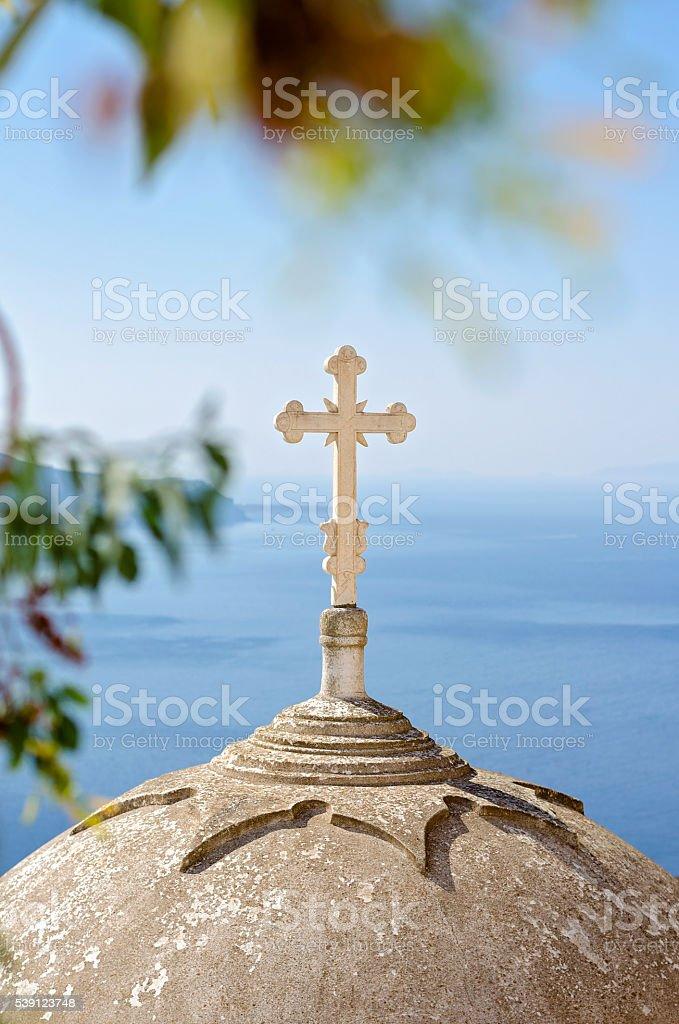 Cross on the church dome in Santorini, Cyclades, Greece stock photo