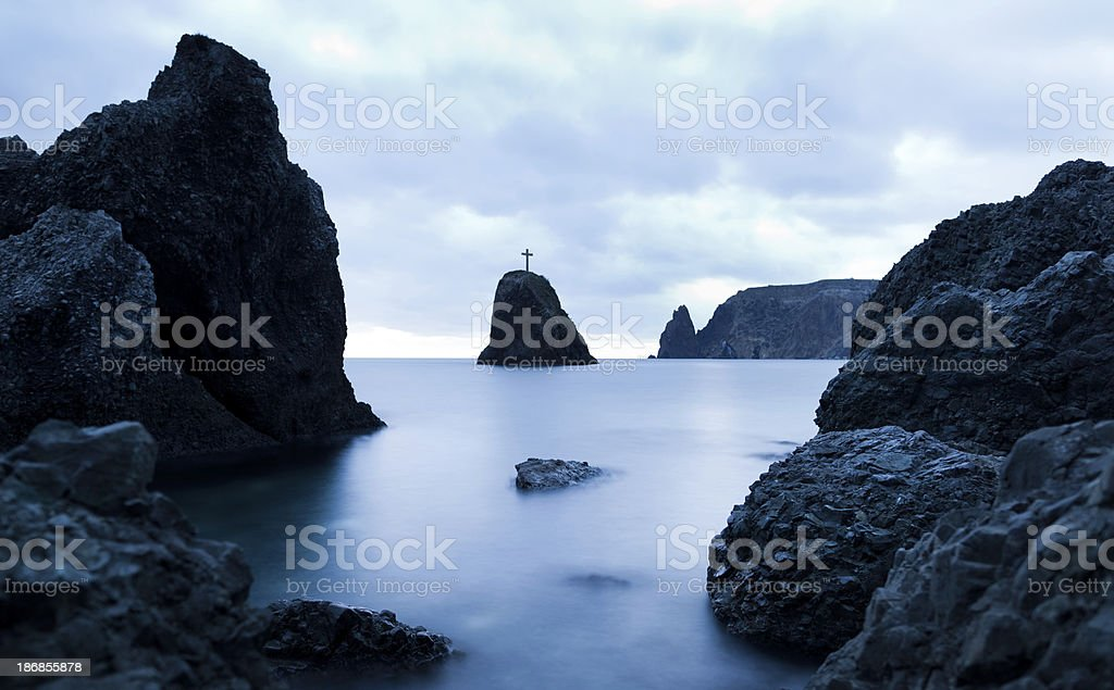 Cross on the rock royalty-free stock photo