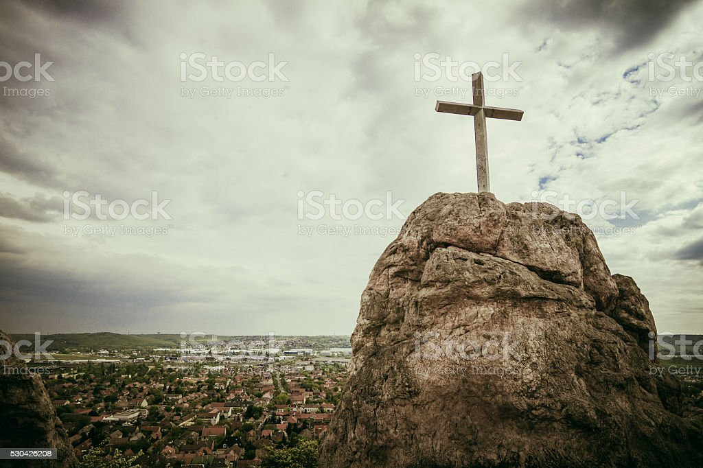 Cross on the rock stock photo