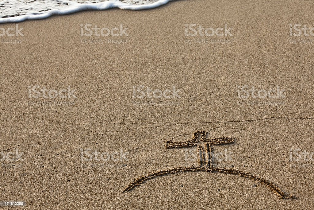 Cross on the Sand royalty-free stock photo