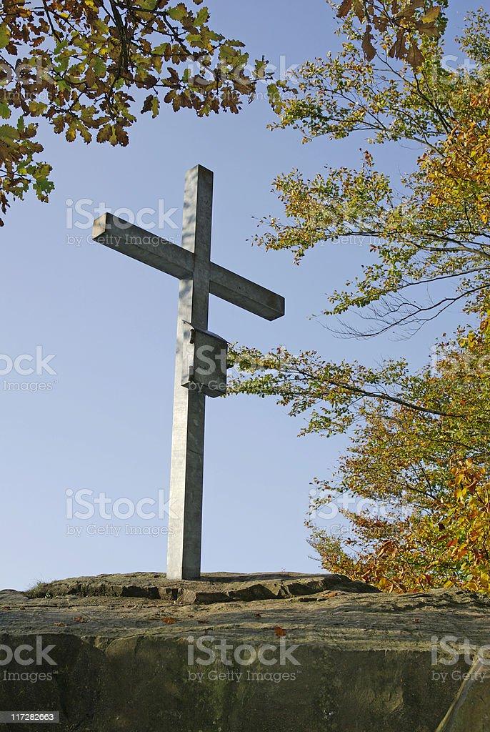 Cross on the summit  in autumn stock photo