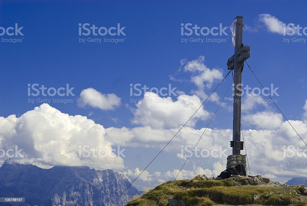 Cross on the top of a mountain stock photo