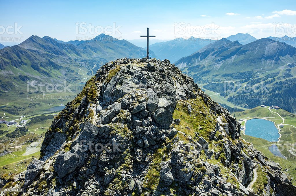 Cross on the top of the peak stock photo