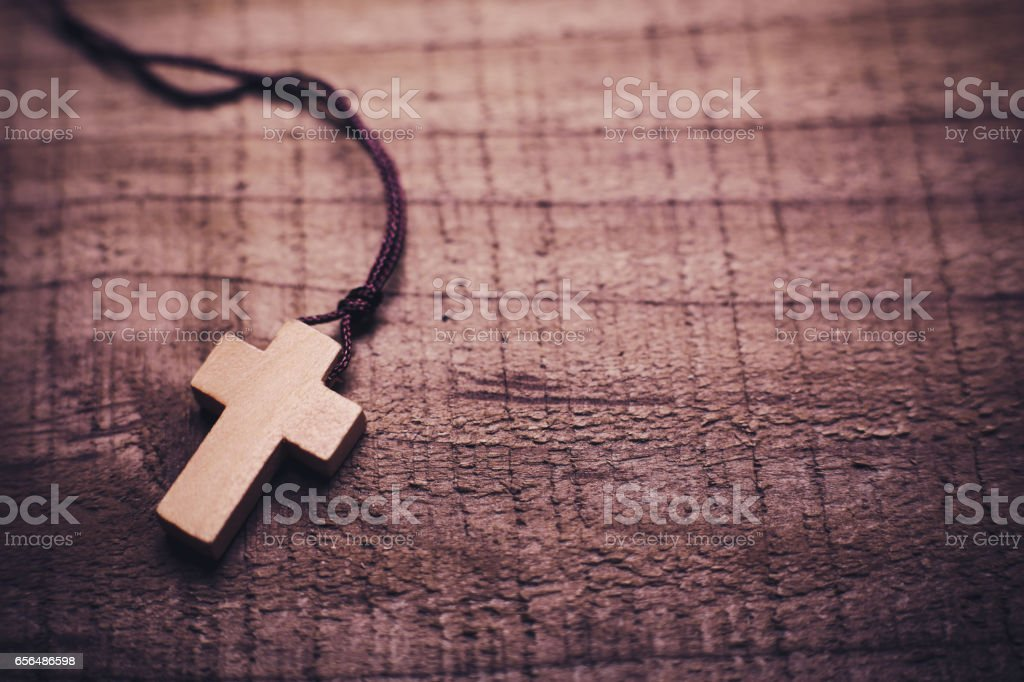 Cross On The Wooden Background stock photo