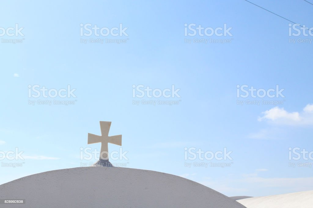 Cross on Top of Greek White Buildings stock photo