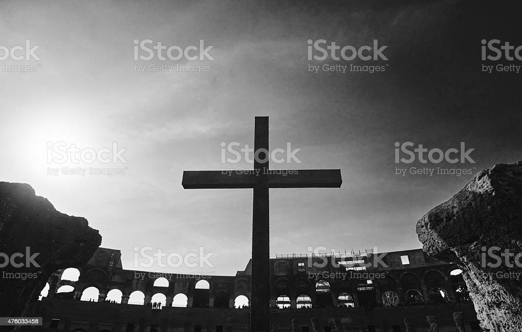 cross over Colloseum ruins stock photo