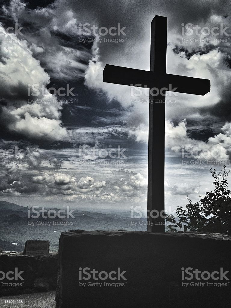 Cross Overlooking A Mountain Landscape stock photo