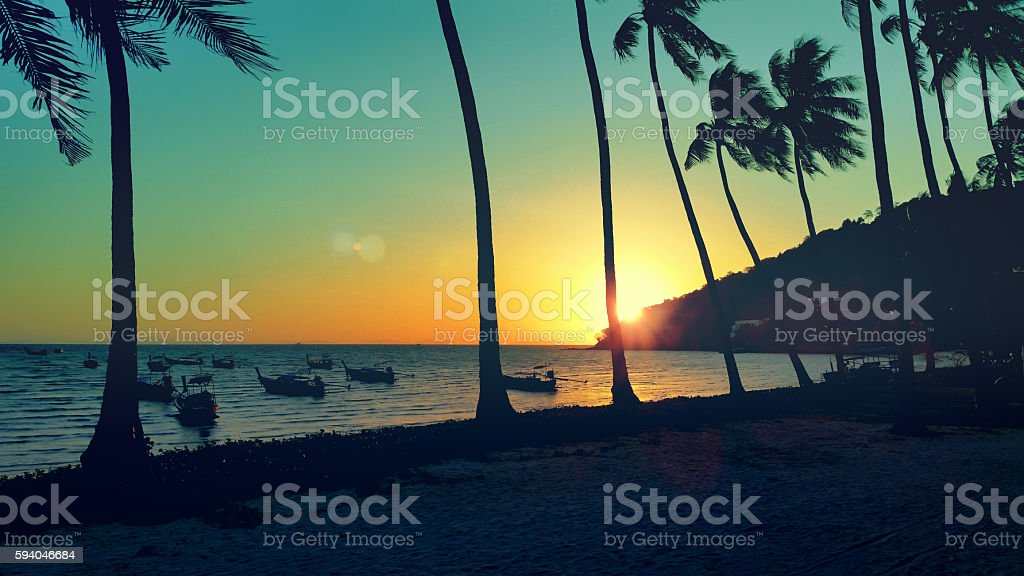 cross processing sunset beach in Thailand stock photo