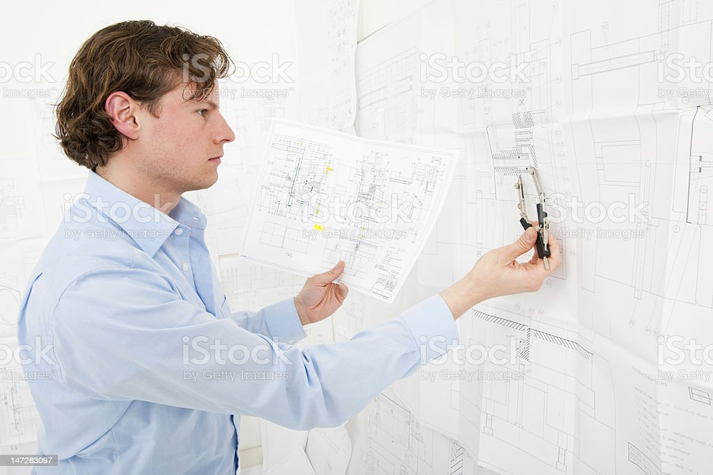 Cross referencing technicasl drawings royalty-free stock photo