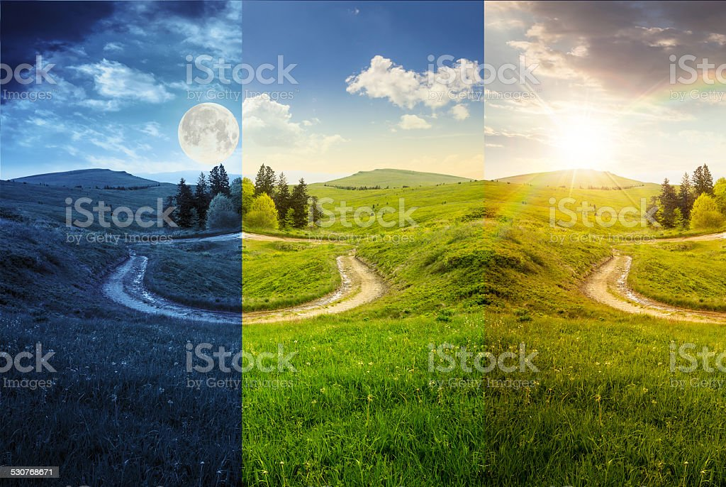 cross road on hillside meadow in mountain stock photo