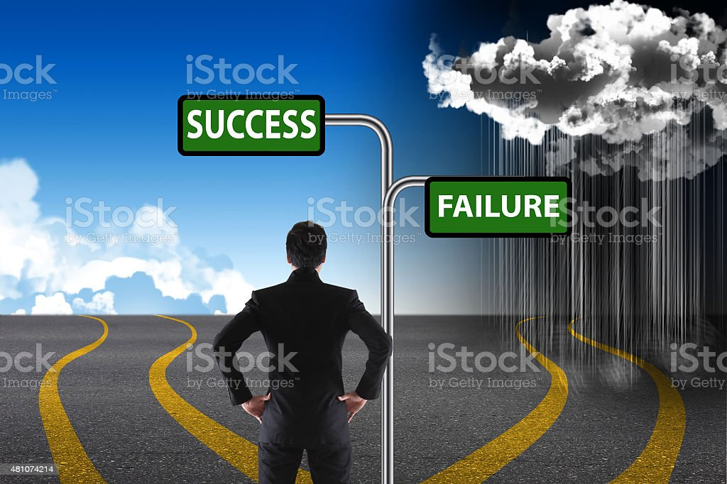 Cross roads with success and failure road signs stock photo
