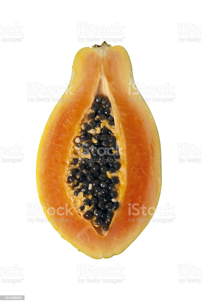 A cross section of a sliced papaya on a white background stock photo