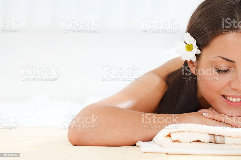 Cross section of a smiling woman enjoying at spa. stock photo