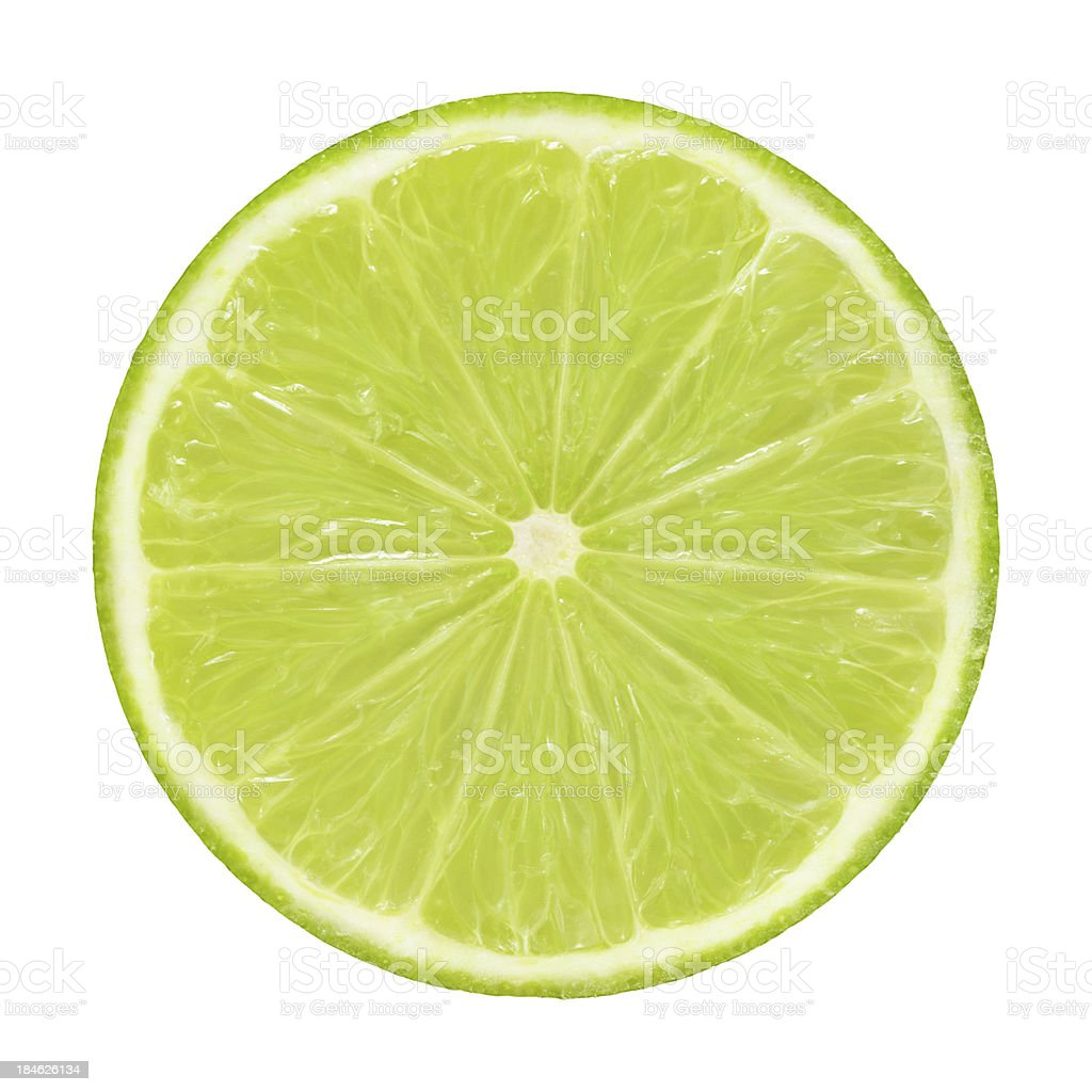 Cross section of lime on white background stock photo