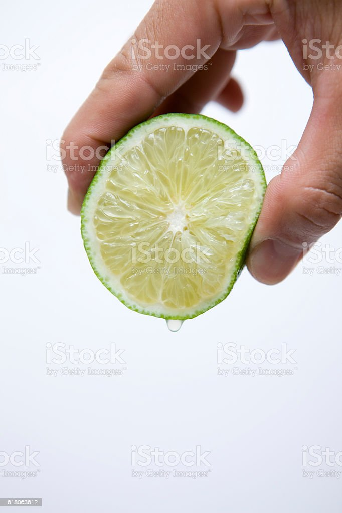 Cross section of lime squeezing stock photo