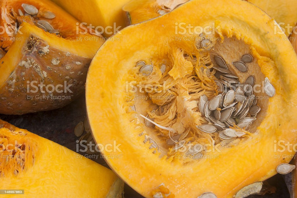 Cross section of pumpkin with seeds stock photo