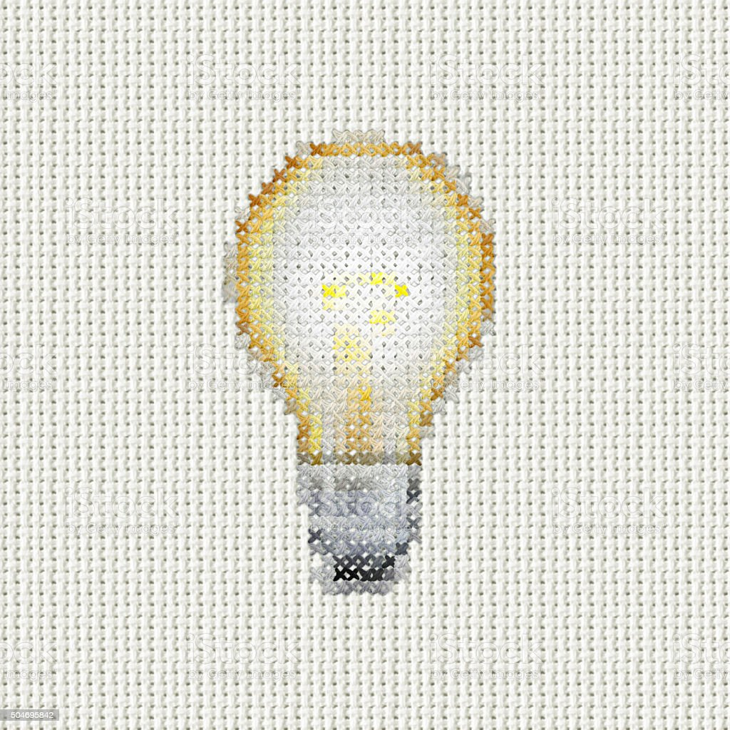cross stitch lightbulb stock photo