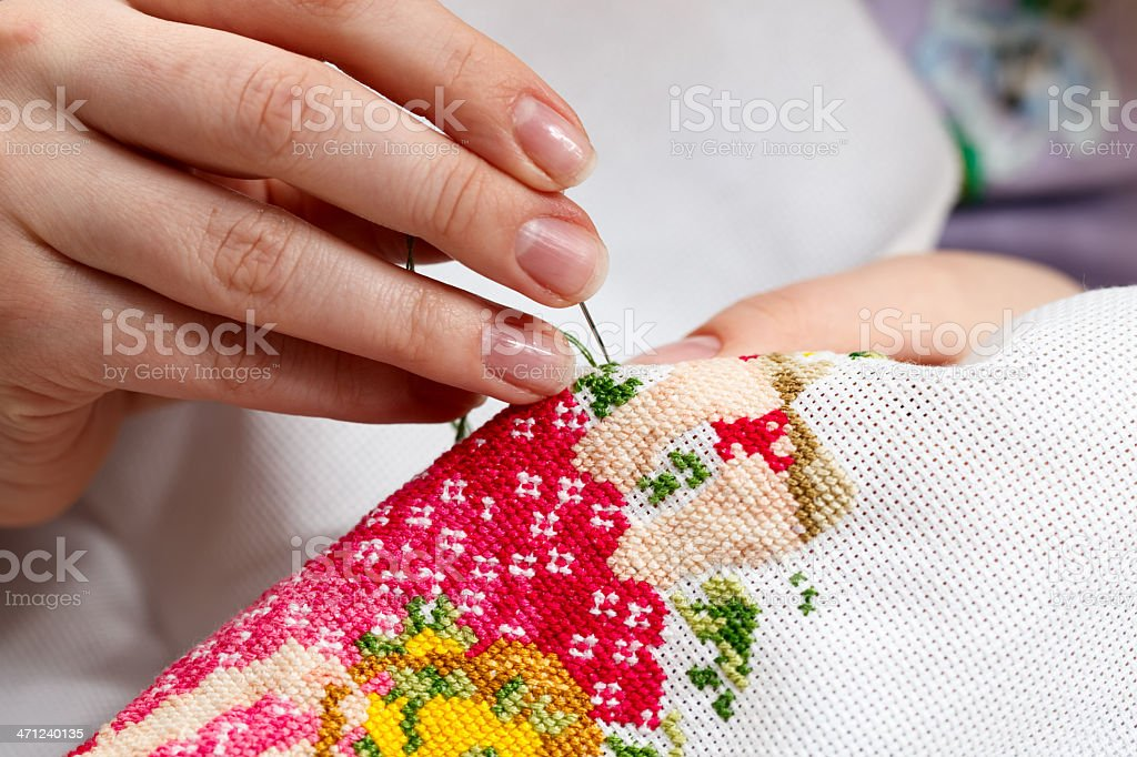 Cross stitching a colorful design royalty-free stock photo
