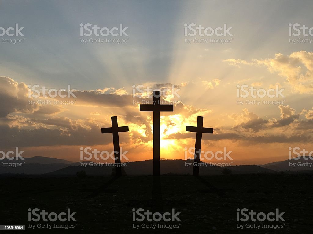 Cross sunset desert stock photo
