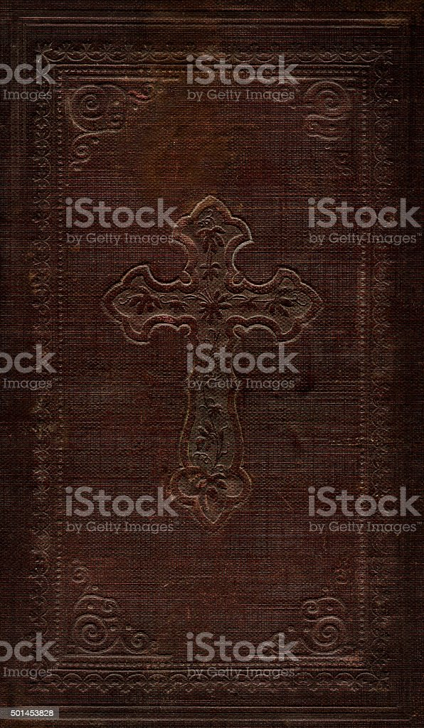 Cross symbol embossed, book cover in relief, late 19th century. stock photo