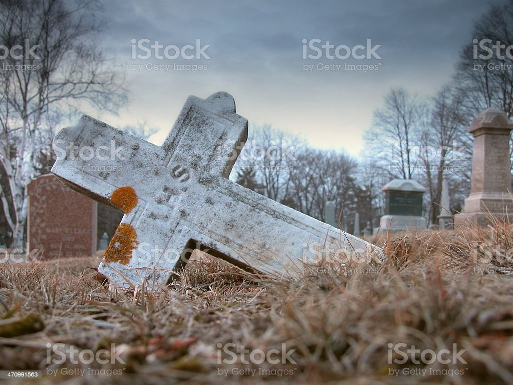 Cross tipped over royalty-free stock photo