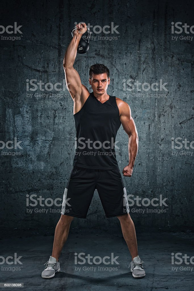 Cross Training With Kettle Bell stock photo