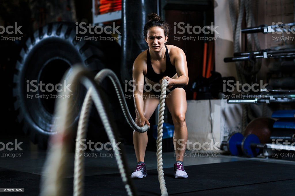 Cross training with rope stock photo
