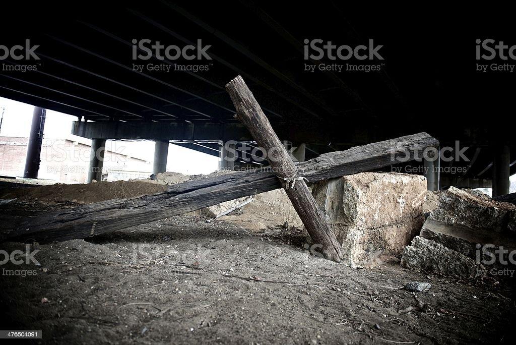 Cross under Bridge stock photo